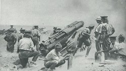 A British battery at work on a sandy ridge in Gallipoli.