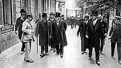British prime minister Lloyd George, French prime minister Clemenceau, and US president Woodrow Wilson in Versailles for the signing of the peace treaty with Germany.